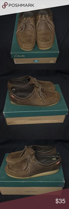 Brown 9M Clarks Shoes. Brown with a few water spots on shoes. Bottoms and shoes is in good condition. Genuine leather Lace ups. Clarks Shoes