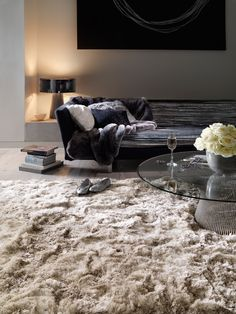 The fluffy beige rug is a warm and soft essential for cold winters.