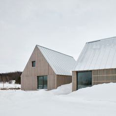 The residence is clad in vertical wood battens and topped with a standing-seam metal roof that is detailed to appear thin and light. Tagged: Exterior, House Building Type, Metal Roof Material, Wood Siding Material, and Gable RoofLine. Modern Farmhouse Design, Modern Barn, Central Building, Agricultural Buildings, Haus Am See, Vernacular Architecture, Architecture Design, Timber Cladding, Wood Siding