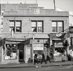"""December 1936. """"Store at which Mrs. Hotchfield does her shopping. Washington Avenue, the Bronx."""" Home of the guaranteed two-day egg, as well..."""