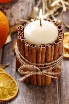 Cinnamon stick candle holder DIY project: Use hot glue to make the cinnamon stick . Cinnamon stick candle holder DIY project: Use hot glue to attach the cinnamon sticks and wrap in gardening yarn. This is one of the ideas for great au. Christmas Candle Decorations, Christmas Candles, Christmas Diy, Fall Decorations, Natural Christmas, Scandinavian Christmas, Diy Candle Holders Christmas, Ideas For Christmas, Christmas Crafts To Make And Sell