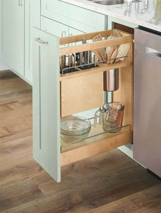 Store the knife block, cooking tools, and canisters in a pull out drawer to free up valuable counter space. They'll still be within reach, but you won't have to worry about knocking them over during meal prep. Do you have a small kitchen and want to take advantage of every nook and cranny? See how Martha maximizes small spaces in this video.