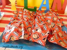 Curious George kids birthday party :: fruit snacks (good idea! We don't usually buy these but an inexpensive and fun way to match the party)