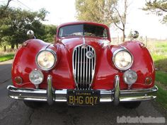 The Jaguar is probably my favorite car of all time.  Here, the 1956 still looks lovely in red.