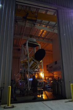 "Giant NASA Balloon Ready to Hunt Potentially Dazzling Comet ISON | Space.com This photo shows the Comet ISON-hunting BRRISON balloon gondola pointing out the door of the hangar for a night time pointing test, to acquire images of stars and planets with both instruments. The instrument will ride a giant NASA balloon to track Comet ISON, the potential ""comet of the century."""