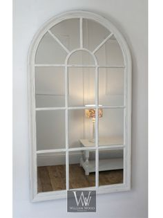 "Delicate arch window style mirror in a shabby chic distressed finish. 2.5"" wide wood and MDF frame finishedin a distressed white finish. This mirror is provided with 2 hangers fitted to back of frame. 