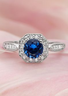 This romantic setting encircles the center sapphire with an octagonal diamond accented border. The pavé-set diamond accents and milgrain detailing give this ring a truly vintage feel.