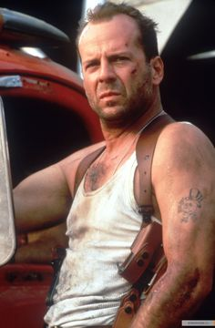 Bruce Willis as John McClane (Die Hard)