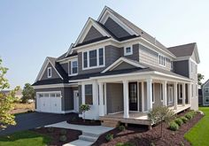 The exterior of this home is painted Sherwin Williams SW7019 Gauntlet Gray. The trim paint color is Sherwin Williams Pure White SW7005.  The front entry door is Sherwin Williams SW 6990 Caviar.
