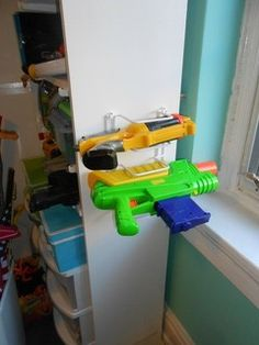 DIY wall mounted NERF gun storage made from wire sorting or plate rack ... because those things will NOT fit in typical bins.