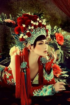 A woman wearing a Chinese opera headdress. Description from pinterest.com. I searched for this on bing.com/images
