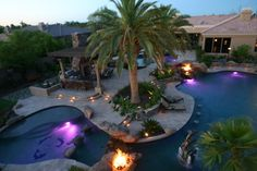 1,000,000$ Private Pool, Gilbert, Arizona. Country's most posh private pool. 10x larger than average family pool & 3x larger than most hotel pools. Has waterfalls, waterslide, fountains, fire features & lighting components. 3 main bodies of water + 15-person hot tub & Koi pond. 2 outdoor kitchens w/ built-in grills & large rotisserie area. Dolphins jump out of the giant pool. The fire, light, mist, and fog features are all remote-controlled and can be accessed by computer, anywhere in the…