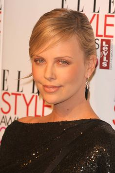 Charlize Theron in Stephen Webster Drop Earrings.