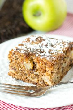 "Apple Walnut Cake is a moist cake with apples and walnuts in every bite. This cake is so full of flavor that no frosting is needed. A simple dusting powdered sugar will do!"" srcset="