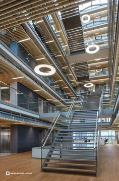 Office Lighting - Wever & Ducré | Our GIGANT provides striking design accents in the atrium of the new cutting-edge headquarters of Vanderlande Industries BV in Veghel, Netherlands. The luminaire is available in two different sizes. Lighting Design: Living Projects Breda, Photographer: 311photography