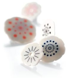 Love simple images on ceramic jewellery by Anne Black