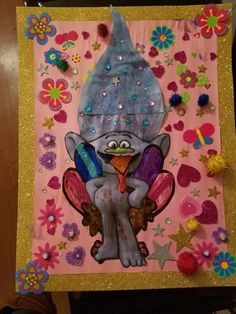 "Turkey disguise project. Using ""Trolls"" activity book poster, glitter poster board, construction paper, markers,and lots of glue,stickers and glitter. (All from Dollar General) A little messy but my 4 yr old wanted to make hers a troll.We did it!"