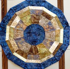 Handcrafted Batik Wagon Wheel Quilted Table by Quiltsbysuewaldrep, $45.00 I love batik fabrics!!