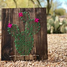 Prickly Pear Cactus String Art Choose any color string and wood stain from our collection. Choice of white or brown nails. Felt flowers are optional and come in yellow, orange or purple. With this project you will assemble the String Art Templates, String Art Patterns, Cactus Craft, Cactus Decor, Cactus House Plants, Cactus Flower, Flower Bookey, Flower Film, Cactus Cactus