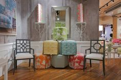 Thibaut Fine Furniture Showroom in High Point, located at #315 Historic Market Square. Seen here: Roundabout Ottoman in South Sea in Green, Fair and Square Ottomans in Soleil in Yellow and Aqua, For the Hex of It Ottomans in South Sea in Tangerine, Dyed Sack in Dust Blue, and South Sea in Pink, Eastwood wallpaper in Grey, Savoy Chair with Arms and Beekman Chair with Arms in Shore in Cream #Thibaut