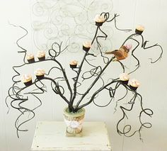 DIY tree cupcake holder.  This is nifty!  I'd use it for halloween and replace the bird with a bat or big, nasty spider.