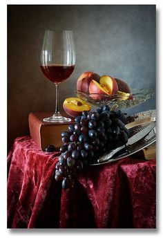 Peaches And Grapes - Still life with glass of red wine, grapes, fresh peaches and old vantage books.  by Nikolay Panov - - https://pixels.com/products/peaches-and-grapes-nikolay-panov-art-print.html
