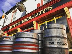 Empty kegs from the night before outside of @mattmolloyspub in #Westport #Ireland. I've never seen so many empty kegs on one street. As I was taking this shot the @guinness truck was pulling up with fresh kegs to replenish the pub for tonight... or this afternoon. #pubculture #beer #ColemanClanTour @irelandtourism