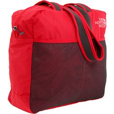 The North Face Flyweight Tote ~$30.00 @ Zappos. Good for bringing extras home in.