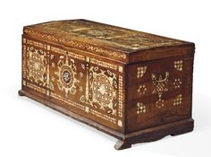 A LARGE PROVINCIAL OTTOMAN MOTHER-OF-PEARL AND TORTOISHELL-INLAID CHEST SYRIA OR TURKEY, 19TH/EARLY 20TH CENTURY Of rectangular shape with flat hinged cover, the inlaid decoration with checkered motifs bordered with cypress trees, two handles at either side (one loose), on later added base, areas of restoration 24¼ x 48 3/8 x 21¾in. (61.5 x 123 x 55cm.)