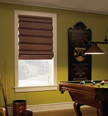 A #brightgreen wall in the #mancave keeps things #fun and #entertaining. The #romanshades will block out light for a manly #movienight. #windowtreatments #pooltable #den