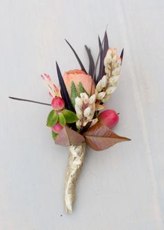 Peach and coral floral boutonniere wrapped in gold washi tape by Holly Chapple. Photo by Cyn Kain. #wedding  See more here: http://www.bellwetherevents.com/