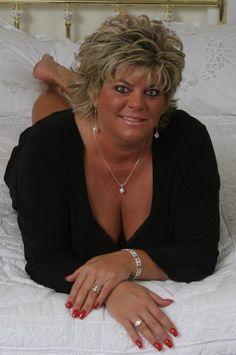 Short busty mature blonde