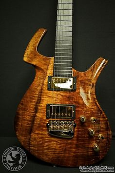 Parker Fly Deluxe - Hawaiian Koa. Saw these babies being built on a factory tour.