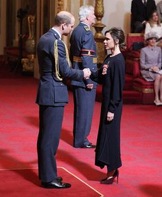 Victoria Beckham has received an OBE from Prince William for her services to the fashion industry – see the photos