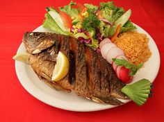 MOJARRA AL HORNO, como preparar esta receta típica de la gastronomía de Cartagena de Indias.  www.cartagenadeindiaslive.com
