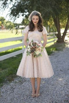 This looks like a classic 50 wedding dress  . Except it would need to be white of course!