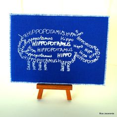Hand Printed Hippo Card Calligram White on Blue by BlueJacaranda via Etsy.
