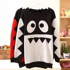 monster face sweater.