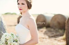 Bridal Portraits in a Field with Hay Bales