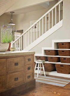 ADDITIONAL STORAGE Love the idea of wicker baskets under the stairs to provide storage, and you can *never* have enough stor­age.
