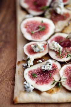 sliced fresh figs roasted on flatbread with sprinkling of rosemary, blue cheese, olive oil, maybe a tiny bit of mint