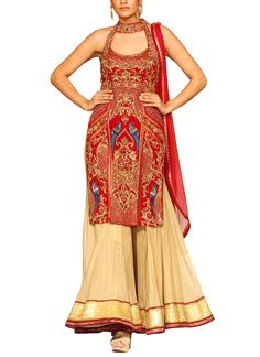 Detailed with a gold georgette sharara, this red velvet tunic set from Mandira Wirk features gorgeous embroidery, cut out details on the front and back, and a long flowing A-line skirt that flatters every figure. The sleeveless bodice is designed with a halter neckline and side slits that allow it to drape smoothly over the skirt.