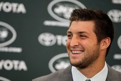 Tim Tebow is so adorable  look at that smile.
