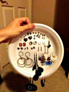 Plate them. If you have any disposable plates, use them to store your jewelry at home or on the go. Take one Styrofoam plate and insert your earrings in the middle, and make holes for your necklaces and bangles on the side. I'd place a Ziploc bag or other packing organizers over to keep your items safe in transit. (Don't pack this much jewelry for any trip!)