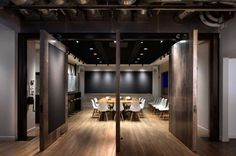 The conference room has enormous doors that swivel around 360 degrees to open and close the space off as needed.