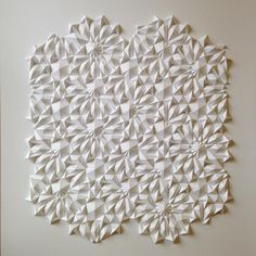 Paper artist Matthew Shlian (previously here and here) combines his talent for sculpture with a knack for engineering, producing geometric works that are composed of tight-knit tessellations. Shlian's receptively folded works have lead to collaborations with scientists at the University of Michigan,