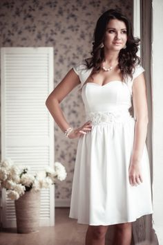 Model 20. A-line short wedding dress - the main fabric is white atlas with elastan, lining with elastan the same, ivory lace; - Sweetheart neckline, boned bodice, molded cups, gathered skirt, faux pearl and crystal-embellished tie at waist ; -concealed zip and lacing fastening along back; -dry clean.
