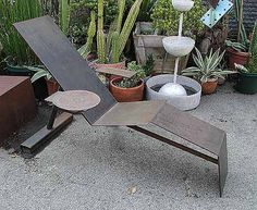 """The """"Margarita Lounge Chair"""" (37x62x41) is a functional art furniture sculpture fabricated in welded steel by california sculptor Bruce Gray..."""