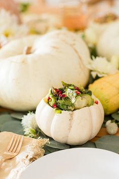 Pumpkin bowls that hold Thanksgiving side dishes.