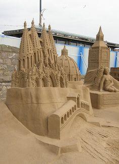 Sand sculpture of European landmarks: London's Big Ben, Florence's Duomo (I think), Barcelona's La Sagrada Familia, etc... photo by Grete Howard